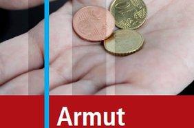 Hand mit Geldstücken